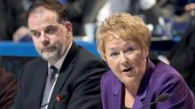 Quebec Premier Pauline Marois delivers opening remarks as Education Minister Pierre Duchesne listens at the education summit Monday. (Paul Chiasson/THE CANADIAN PRESS)