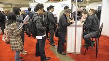 Hundreds line up for various booths at the The National Job Fair and Training Expo earlier this year at the Metro Toronto Convention Centre. (J.P. MOCZULSKI For The Globe and Mail)