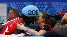 Canada's Charles Hamelin kisses his girlfriend and compatriot speed skater Marianne St-Gelais after winning the men's 1,500 metres short track speed skating race finals at the Iceberg Skating Palace during the 2014 Sochi Winter Olympics February 10, 2014. (David Gray/REUTERS)