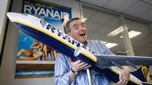 Ryanair CEO Michael O'Leary holds a model plane as he talks to the Globe and Mail at his headquarters at Dublin Airport, Ireland, Thursday, Nov. 20, 2008. (AP Photo)