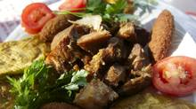 Griot de porc with malanga accras at Marche Meli-Melo in Montreal. (Adam Gollner for The Globe and Mail)