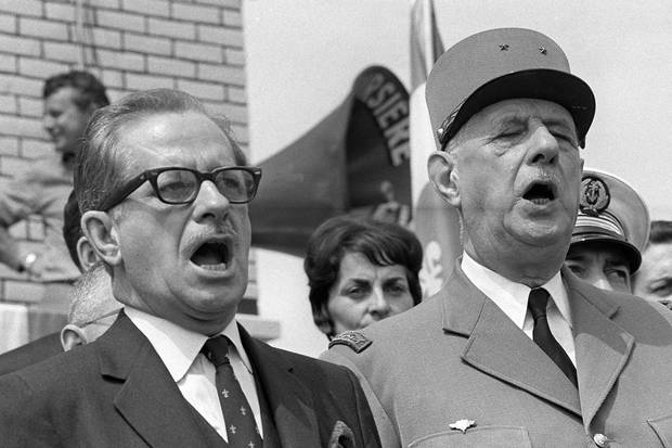 July 24: Quebec's premier Daniel Johnson sings the national anthem in Montreal with Gen. de Gaulle.