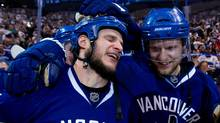 Vancouver Canucks' Kevin Bieksa, left, who scored the game-winning goal, and Alexander Edler, of Sweden, celebrate after defeating the San Jose Sharks in the second overtime period of game 5 of the NHL Western Conference Final Stanley Cup playoff hockey series in Vancouver, B.C., on Tuesday May 24, 2011. Vancouver won the series 4 games to 1 and advances to the Stanley Cup Final. (DARRYL DYCK)