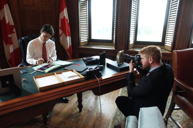 The Prime Minister goes about his business apparently oblivious to the snapping of Adam Scotti, which he says he tunes out – unless there is something he can do to make a shot better.