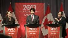 Federal Liberal Party leadership candidates Martha Hall Findlay, Justin Trudeau and Martin Cauchon, left to right, laugh during a debate on March 3, 2013. The federal Liberals are weeding out duplicate names and mischief makers as they count the Canadians who are eligible to vote for their new leader, but party sources say the final number will approach 300,000. (Devaan Ingraham/Reuters)