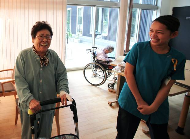 Misao Shimamura and her caregiver. (Iain Marlow/The Globe and Mail)