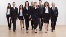 Group of business executives approaching. Thinkstock (Andrey Popov/Thinkstock)