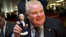 Mayor Rob Ford signs bobble head dolls for supporters at city hall in Toronto, Ontario Tuesday, November 12, 2013. (Kevin Van Paassen/The Globe and Mail)