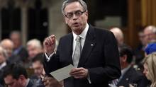 Canada's Finance Minister Joe Oliver speaks during Question Period in the House of Commons on Parliament Hill in Ottawa on March 27, 2014. (CHRIS WATTIE/REUTERS)