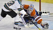 San Jose Sharks' Dan Boyle (L) scores the winning shootout goal against Edmonton Oilers' goalie Devan Dubnyk during overtime of their NHL game in Edmonton March 20, 2013. (DAN RIEDLHUBER/REUTERS)