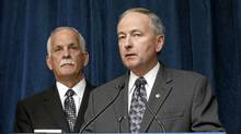 Public Safety Minister Vic Toews (left)and Justice Minister Rob Nicholson take part in a news conference to announce measures protecting children from internet predators, in Ottawa, Tuesday, Feb. 14, 2012. (FRED CHARTRAND/THE CANADIAN PRESS/FRED CHARTRAND/THE CANADIAN PRESS)