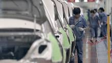 In this June 21, 2012 photo, a worker assembles an automobile at Chinese automaker Geely Cixi Manufacture Base in Cixi, China. (Eugene Hoshiko/AP)