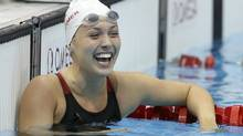 Canada's Summer Ashley Mortimer celebrates winning gold in the women's 50m Freestyle S10 final at the 2012 Paralympics, Friday, Aug. 31, 2012, in London. (Associated Press)