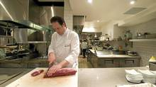 Yorkville chef Bradley Macdonald prepares bison meat in his kitchen at Sassafraz in Toronto (Kevin Van Paassen/Kevin Van Paassen/The Globe and)
