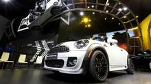 The 2013 Mini Cooper exhibit is displayed at the North American International Auto Show in Detroit, Monday, Jan. 9, 2012. (Paul Sancya/AP Photo/Paul Sancya)