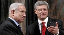 Prime Minister Stephen Harper shakes hands with Israel's Prime Minister Benjamin Netanyahu in the Rotunda on Parliament Hill in Ottawa on March 2, 2012. (CHRIS WATTIE/REUTERS/CHRIS WATTIE/REUTERS)