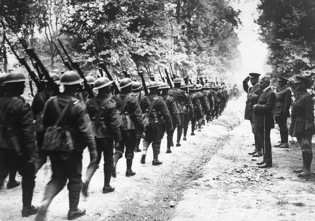 A Canadian battalion marches past Sir Robert Borden, then prime minister of Canada, in France on July 1, 1918. General Arthur Currie, the senior Canadian commander at Vimy Ridge, is on the right.