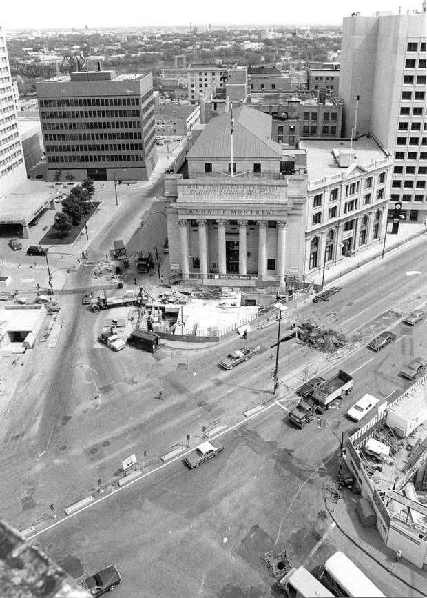 1978: City crews overhaul the pavement at Portage and Main, replacing existing sidewalks with paving stone walks in front of the bank building.