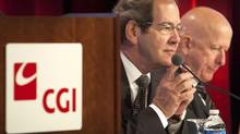 CGI Group Inc. founder Serge Godin, left, and chief executive Michael Roach. (Ryan Remiorz/THE CANADIAN PRESS)
