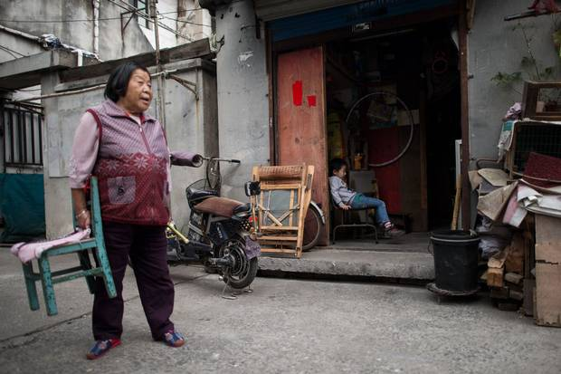 Oct. 27, 2014: Six-year-old Pan Yulin, middle, who is from Hefei in Anhui province, rests in his aunt's house, after his school was shut down by authorities in Shanghai's Baoshan district. Without the right hukou documents, Chinese children do not qualify for places in public schools, making illegal fee-paying migrant schools their only option.