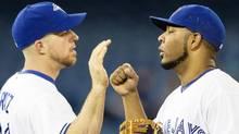 Toronto Blue Jays' Edwin Encarnacion and Erik Kratz celebrate (Chris Young/THE CANADIAN PRESS)