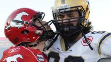 Calgary Stampeders' quarterback Drew Tate (L) sends a kiss towards Winnipeg Blue Bombers' Glenn January after the Stampeders defeated the Blue Bombers 30-24 in their CFL football game in Calgary, Alberta, November 5, 2011. REUTERS/Todd Korol (Todd Korol/Reuters)