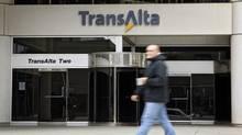 A pedestrian walks past the TransAlta building in downtown Calgary, Monday, Oct. 5, 2009. (Jeff McIntosh/The Canadian Press)
