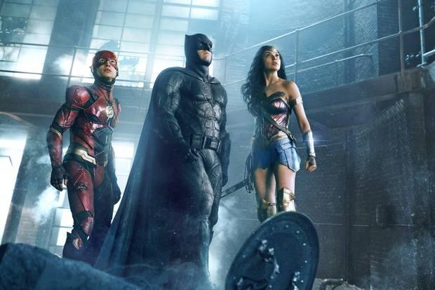 Ezra Miller as the Flash, Ben Affleck as Batman and Gal Gadot as Wonder Woman in Justice League.