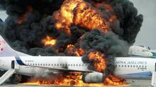 File photo of a China Airlines airplane burning after an explosion in Naha on Japan's southern island of Okinawa August 20, 2007. All 165 passengers and crew escaped safely. REUTERS/Kyodo (KYODO)