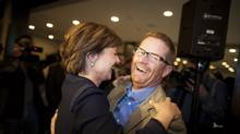 BC Premier Christy Clark is greeted by Environment Minister Terry Lake as she arrives for her first BC Liberal candidate caucus meeting in Vancouver, British Columbia, Thursday, May 23, 2013. (Rafal Gerszak For The Globe and Mail)