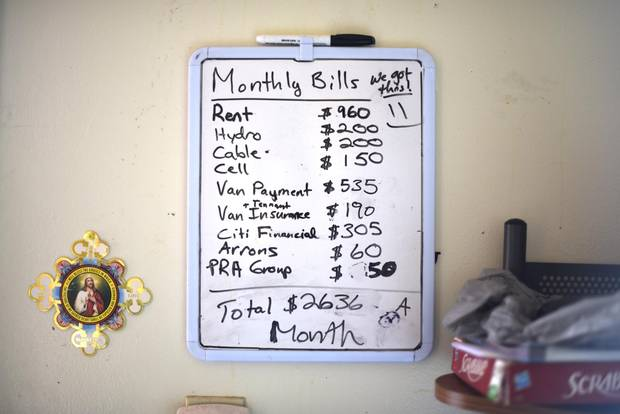 A board with the family's monthly expenses are posted on the wall at John and Brandy Childforever's Thunder Bay, Ont. home.