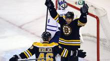 The Boston Bruins Nathan Horton is congratulated by teammate David Krejci after Horton scored a goal against Toronto Maple Leafs goaltender James Reimer in the first period of Game 1 of their NHL Eastern Conference quarter-finals hockey game in Boston, Massachusetts May 1, 2013. (BRIAN SNYDER/REUTERS)