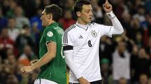 Germany's Mesut Ozil (R) celebrates after scoring against Ireland during their 2014 World Cup qualifying soccer match at the Aviva Stadium in Dublin October 12, 2012. (CATHAL MCNAUGHTON/REUTERS)