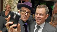 Elvis Costello and Matt Damon attend the ONEXONE dinner in Toronto, September 13, 2009. (George Pimentel/WireImage/George Pimentel/WireImage)