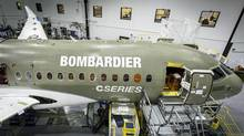 A Bombardier CSeries jet under construction in Mirabel, Quebec. The fuel-efficient jet is set to make its maiden flight this month. (Bombardier/Reuters)