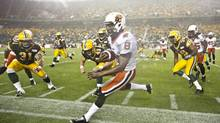 B.C. Lions' Korey Williams (8) run out of bounds as he is chased by the Edmonton Eskimos Calvin McCarty (3), Mike Cornell (49) and Eric Samuels (38) during first half action in Edmonton, Alta., on Saturday July 13, 2013. (JASON FRANSON/THE CANADIAN PRESS)