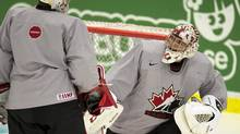 Team Canada goaltenders Jake Paterson (right) and Zachary Fucale share a laugh during team practice at the IIHF World Junior Hockey Championships in Malmo, Sweden on Friday December 27, 2013. (FRANK GUNN/THE CANADIAN PRESS)