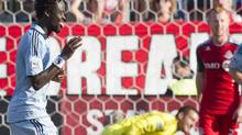 Sporting Kansas City's Kei Kamara, left, celebrates after scoring the winning goal against Toronto FC on Saturday at BMO Field. (Chris Young/THE CANADIAN PRESS)