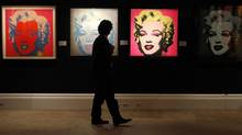 Andy Warhol's 1962 screenprints of Marilyn Monroe came eight years after Willem de Kooning's own portrait of the actress. (SUZANNE PLUNKETT/REUTERS)