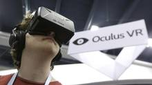 Oh sure, everyone will be walking around like this in a few years. Peter Mason tries the Oculus virtual reality headset at the Game Developers Conference 2014 in San Francisco, Wednesday, March 19, 2014. (Jeff Chiu/AP)