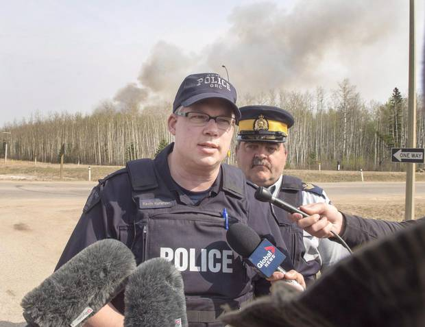 RCMP Inspector Kevin Kunetzki updates the media on the highway to Fort McMurray, Alta., on Saturday, May 7, 2016.