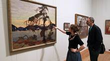 Exhibition officer Amy Concannon views Canadian artist Tom Thomson's 1917 oil painting The Jack Pine at the Dulwich Picture Gallery in London, October 14, 2011. The gallery hosted Painting Canada: Tom Thomson and the Group of Seven from October 19, 2011 to January 8, 2012. (CHRIS HELGREN/REUTERS)