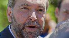 NDP leader Thomas Mulcair speaks to reporters during the official opening of Jack Layton park in the town of Hudson, Que., on June 23, 2012. (Graham Hughes/THE CANADIAN PRESS)
