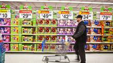 Thomas Underwood is seen shopping in the toy section of Walmart in Mississauga on December 2, 2011. (JENNIFER ROBERTS For The Globe and Mail)