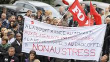 France Telecom employees demonstrate on Tuesday in Marseille against the company's restructuring. (GERARD JULIEN)