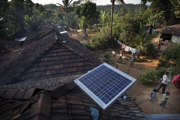 Solar panels sit on houses in Paradeshappanamatha, India.