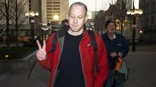 Byron Sonne, 39, who's trial began Monday, leaves the courthouse in Toronto. Police allege he assembled homemade explosives and incited others to tear down the G20 security fence and surveillance cameras through his Twitter and Flickr accounts. (Kevin Van Paassen/The Globe and Mail/Kevin Van Paassen/The Globe and Mail)
