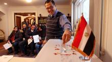 Nabil Salamoun of Burlington, Ont., casts a ballot at the Egyptian Embassy in Ottawa, Jan. 11, 2014. (Dave Chan For the Globe and Mail)