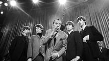 Ed Sullivan with the Beatles on Feb. 9, 1964, during a rehearsal just before their first appearance on The Ed Sullivan Show. (AP)