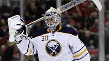 Buffalo Sabres goalie Ryan Miller heads to the bench after being replaced by Jhonas Enroth in the second period of an NHL hockey game against Detroit Red Wings in Detroit, Monday, Jan. 16, 2012. (Paul Sancya/AP)